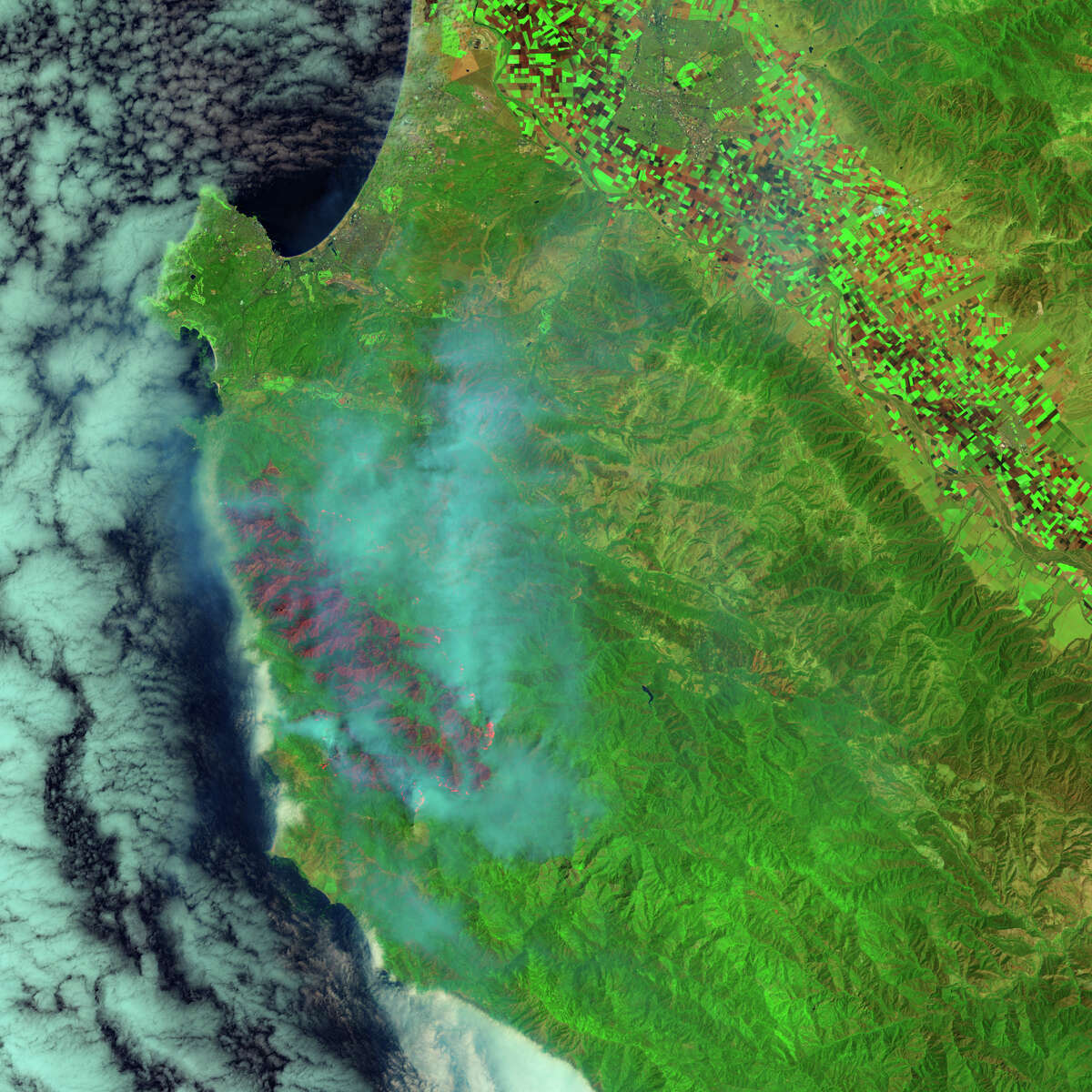 Smoke from the Soberanes Fires wafts eastward from the wildfire's 43,400 burn scar in a photo from NASA's Landsat 8 satellite. The fire was only 18 percent contained as of Tuesday.