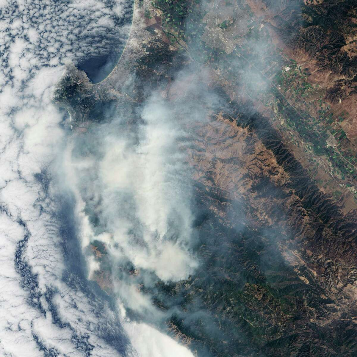 In a natural-color image, captured by NASA's Operational Land Imager on the Landsat 8 satellite, shows thick smoke obscuring the land surface over the Soberanes Fire.