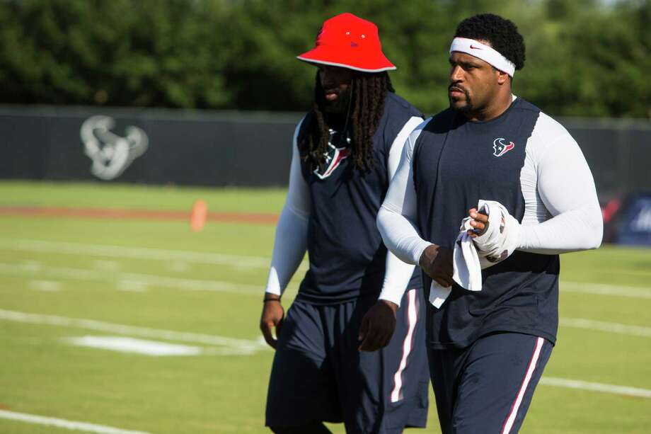 Houston Texans tackles Derek Newton, left, and Duane Brown walk on the practice field during Texans training camp at Houston Methodist Training Center on Tuesday, Aug. 2, 2016, in Houston. Both offensive linemen are recovering from injury and unable to practice. Photo: Brett Coomer, Houston Chronicle / © 2016 Houston Chronicle