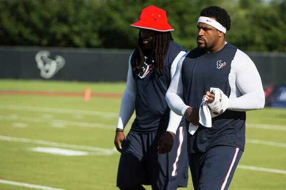 Houston Texans tackles Derek Newton, left, and Duane Brown walk on the practice field during Texans training camp at Houston Methodist Training Center on Tuesday, Aug. 2, 2016, in Houston. Both offensive linemen are recovering from injury and unable to practice.