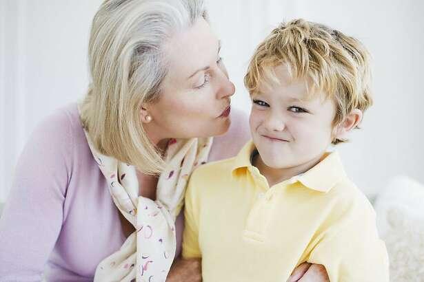 Grandson refusing grandmothers kiss