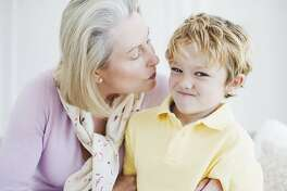 Grandson refusing grandmothers kiss