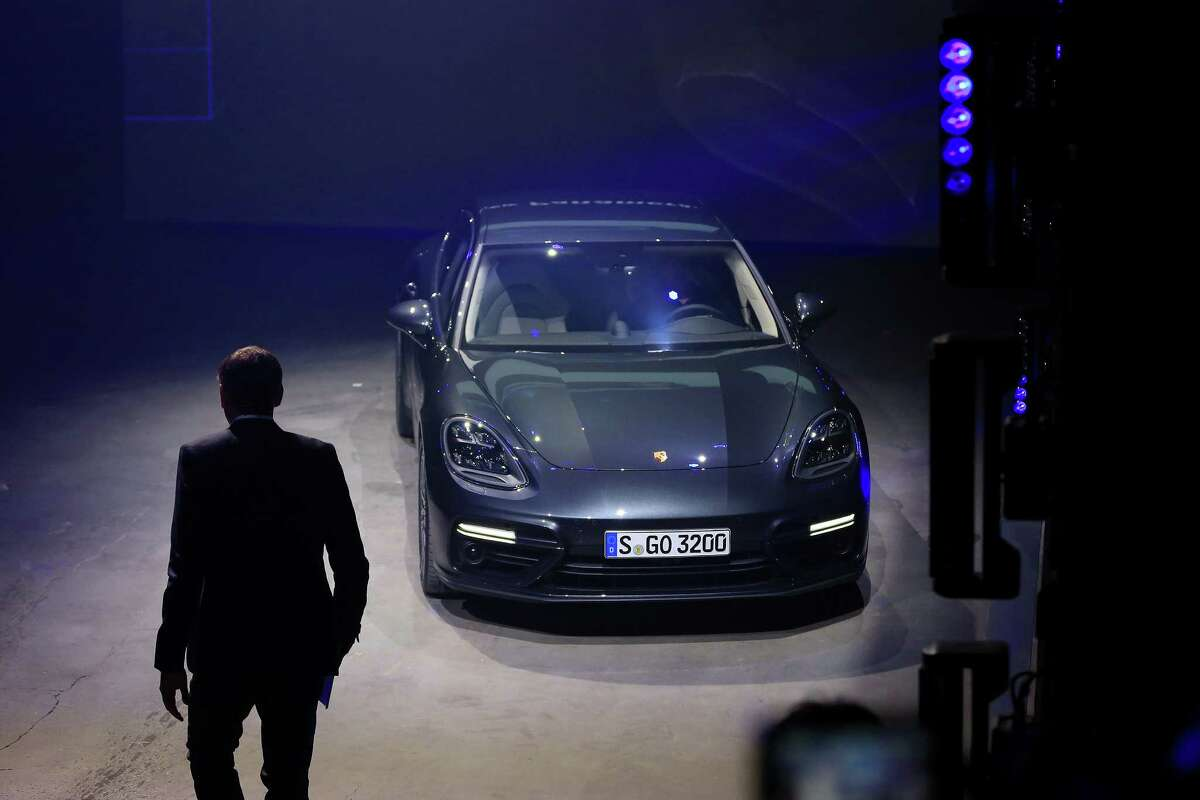 Oliver Blume, chief executive officer of Porsche AG, walks towards the company's new Panamera Turbo coupe as Volkswagen AG's luxury unit unveils the new generation of the automobile in Berlin, Germany, on Tuesday, June 28, 2016.