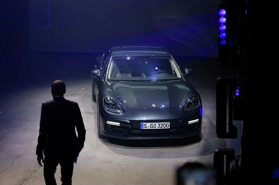 Oliver Blume, chief executive officer of Porsche AG, walks towards the company's new Panamera Turbo coupe as Volkswagen AG's luxury unit unveils the new generation of the automobile in Berlin, Germany, on Tuesday, June 28, 2016. Photo: Krisztian Bocsi / © 2016 Bloomberg Finance LP