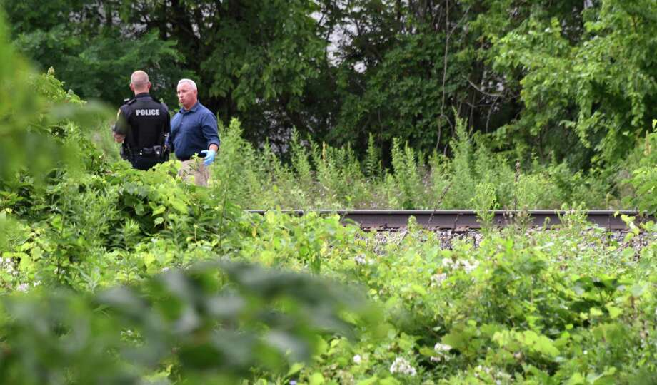 Investigators search the railroad tracks near Wilmarth St. on Tuesday, Aug. 2, 2016, in Scotia, N.Y.  (John Carl D'Annibale / Times Union) Photo: John Carl D'Annibale