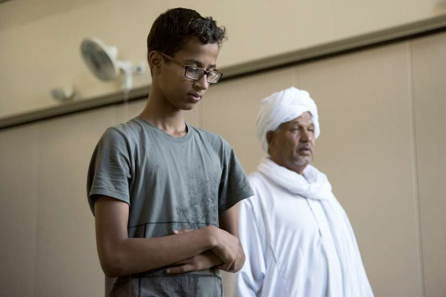 Ahmed Mohamed and his father pray at the Islamic Center of Irving in Irving, Texas. After moving to Qatar for nine months, Ahmed is home in Texas for the summer. Photo: Cooper Neill /For The Washington Post