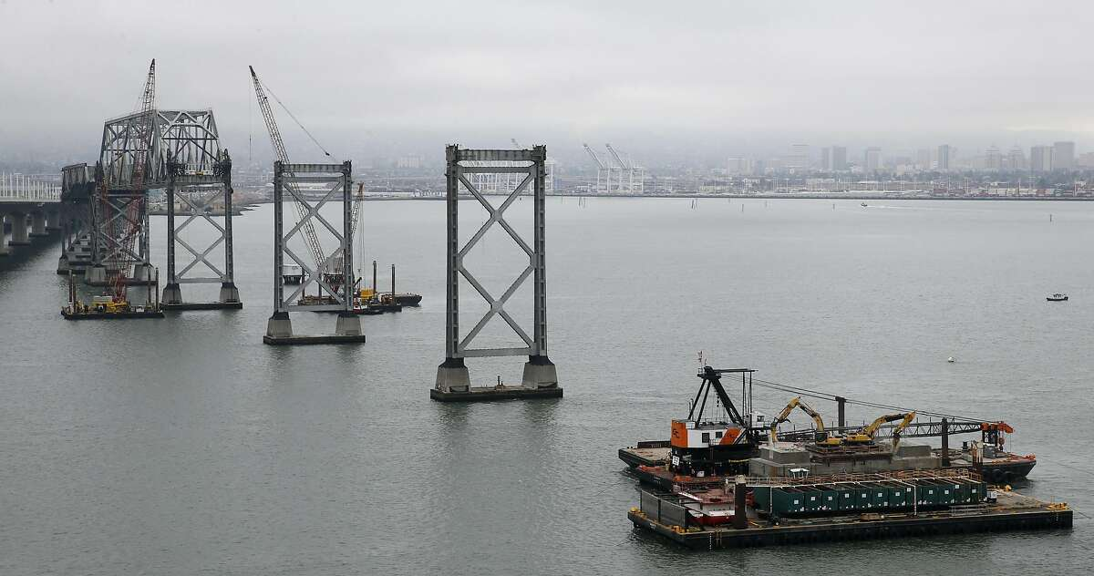 Demolition work on the old eastern Bay Bridge continues in Oakland, Calif. on Tuesday, Aug. 2, 2016.