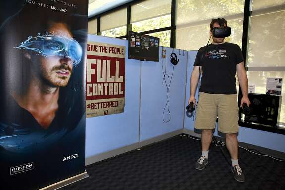 Technologist Eric Szymaszek plays Tilt Brush using a virtual reality gaming system in the Radeon Game Room at AMD headquarters in Sunnyvale, California, on Tuesday, August 2, 2016.