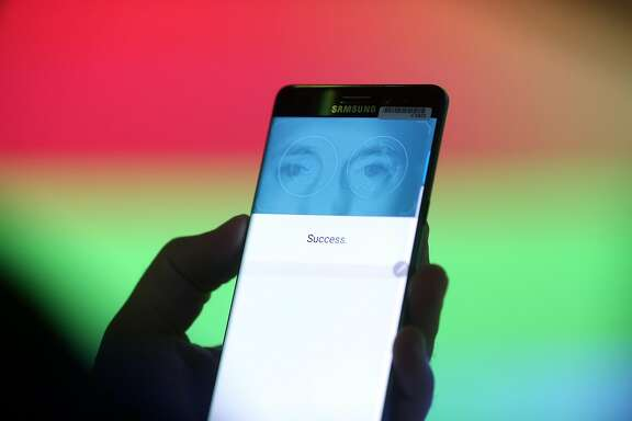 A visitor tests the iris scanning security capability on the Galaxy Note 7 smartphone during a Samsung Electronics Co. 'Unpacked' launch event in London, U.K., on Tuesday, Aug. 2, 2016. The South Korean company announced the latest iteration of its large-screen smartphone with the 5.7-inch Note 7 that can be unlocked with an iris-scanning camera. Photographer: Chris Ratcliffe/Bloomberg
