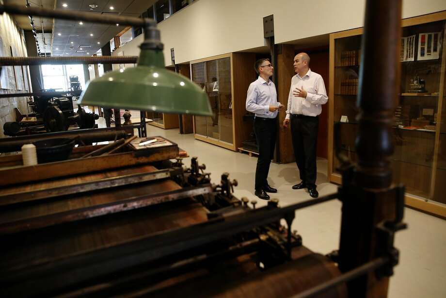 Hamish Corner, (left) and James Klein of Penningtons Manches LLP, during a lunchtime seminar at the American Bookbinders Museum in San Francisco, California, as seen on Tues. Aug. 2, 2016. The museum offsets the ever escalating costs of operating in the city of San Francisco by renting out their place to local businesses through Peerspace a kind of Airbnb for commercial meetings and activities. Photo: Michael Macor, The Chronicle