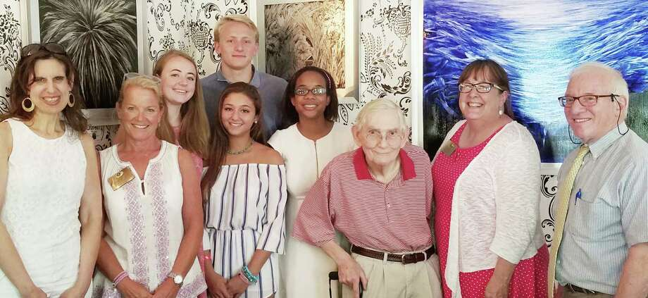 Five New Canaan High School graduates won the Kiwanis Club of New Canaan's Harold S. Kenney Scholarship' Awards at the Roger Sherman Inn on July 21, 2016. From left: Kiwanis members Joyce Sixsmith and Tucker Murphy; scholarship recipients Sophie Salomon, Katie Marciano, Claire Perry and Andrew Chalon; and Kiwanis members David Borglum (NCHS class of 1949), BJ Flagg and Sperry DeCew (NCHS class of 1965). Photo: Contributed Photo / Hearst Connecticut Media / New Canaan News