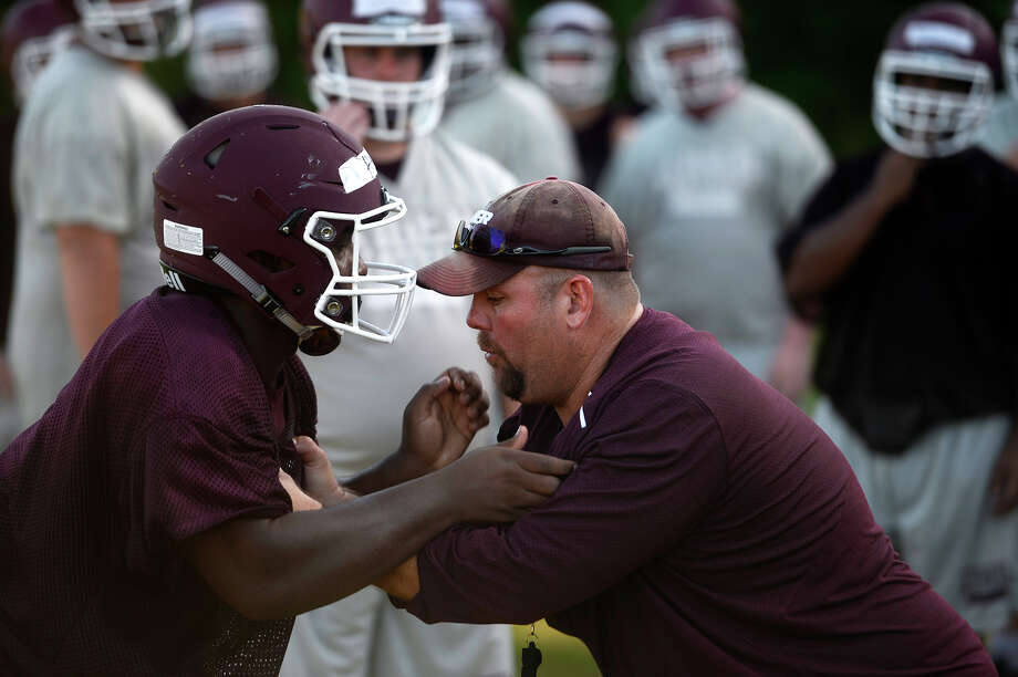 Silsbee coach Randy Smith demonstrates blocking technique during drills with the linemen at their football practice on Tuesday morning.  Photo taken Tuesday 8/2/16 Ryan Pelham/The Enterprise Photo: Ryan Pelham / ©2016 The Beaumont Enterprise/Ryan Pelham
