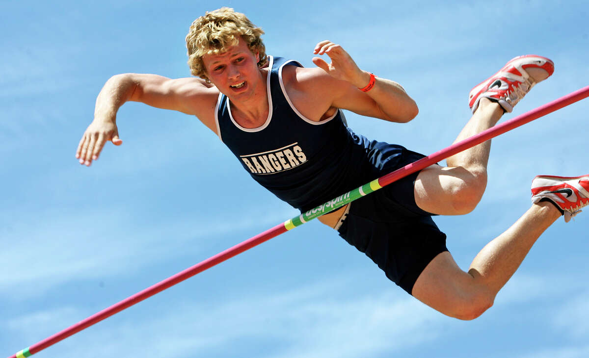 Smithson Valley's Logan Cunningham tries to squeeze over 17 feet after clearing 16'6