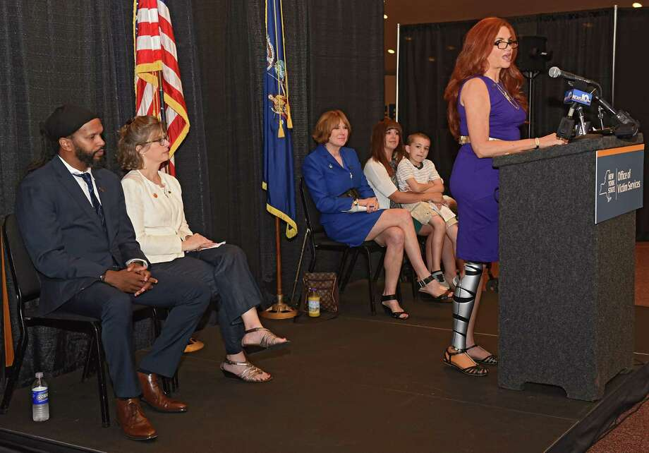 Theresa Sareo of Manhattan speaks as the New York State Office of Victim Services marks its 50th anniversary of service to innocent crime victims and their families at the Empire State Plaza on Tuesday, Aug. 2, 2016 in Albany, N.Y. Sareo lost her right leg when she was hit by an impaired driver. (Lori Van Buren / Times Union) Photo: Lori Van Buren / 20037524A