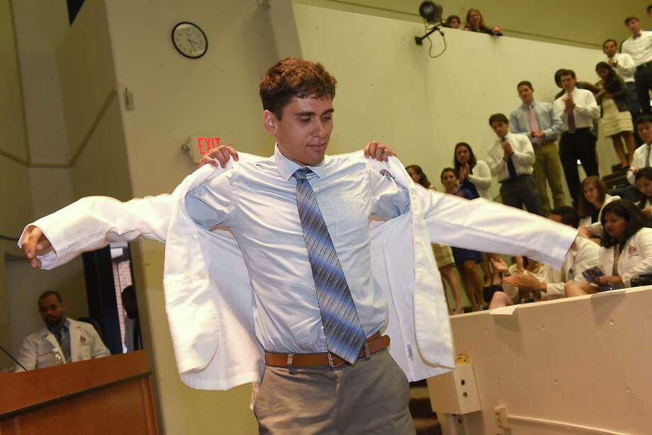 New medical student Zachary Robbiano of Burnt Hills receives his medical lab coat during the traditional white coat ceremony at Albany Medical College on Tuesday, Aug. 2, 2016 in Albany, N.Y.  (Lori Van Buren / Times Union) Photo: Lori Van Buren / 20037506A