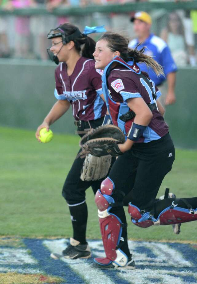 Teammates Maddie McKay and Jackie Kirkpatrick return from foul territory after McKay caught a pop-up in front of the Rowan dugout for the final out in Wednesday's championship game. Photo: David Ball
