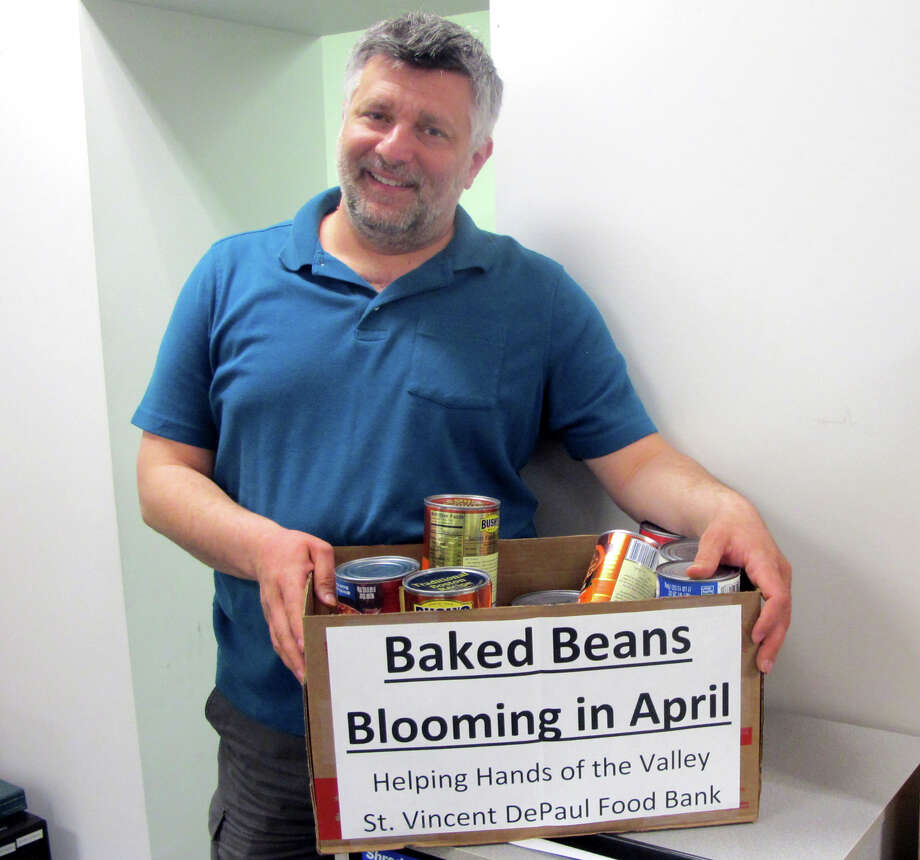 City/Town Clerk Marc Garofalo, a former four-term Derby mayor, stands near the collection box for Baked Beans in his office in Derby, Conn. on Friday, April, 22, 2016. Garofalo was instrumental in creating the monthly City Hall food drive for St. Vincent De Paul's food bank. Photo: Michael P. Mayko / Hearst Connecticut Media / Connecticut Post