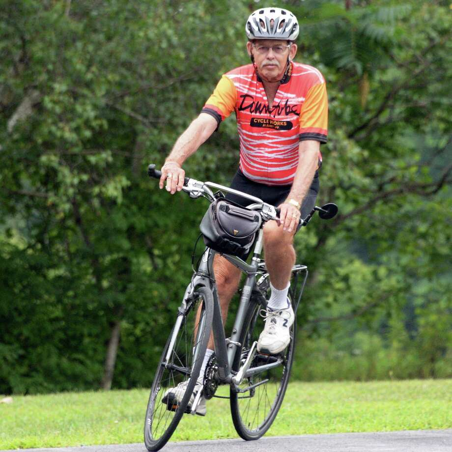 David Kretzschmar, 74, starts his bike ride through his neighborhood Friday July 29, 2016 in Castleton, NY. Kretzschmar is closing in on 100,000 miles of bike riding in the past decade or so, and advocates cycling for fitness among seniors.   (John Carl D'Annibale / Times Union) Photo: John Carl D'Annibale / 20037489A