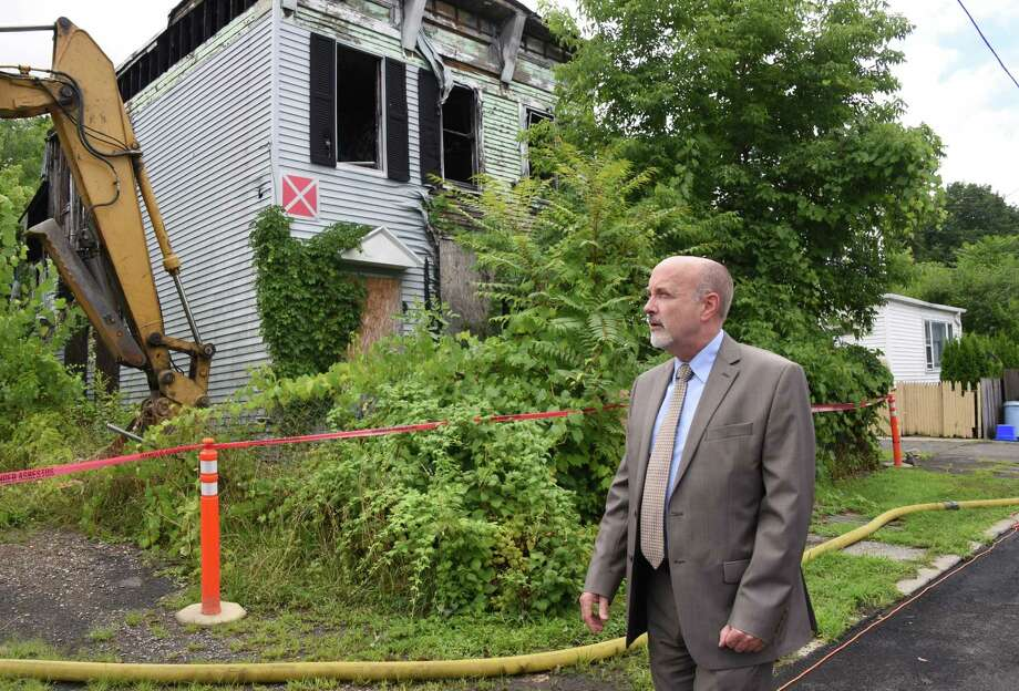 Mayor Patrick Madden awaits demolition to begin at an abandoned property at 3, Cragin Avenue Tuesday August 2, 2016 in Troy, NY.  (John Carl D'Annibale / Times Union) Photo: John Carl D'Annibale / 20037519A