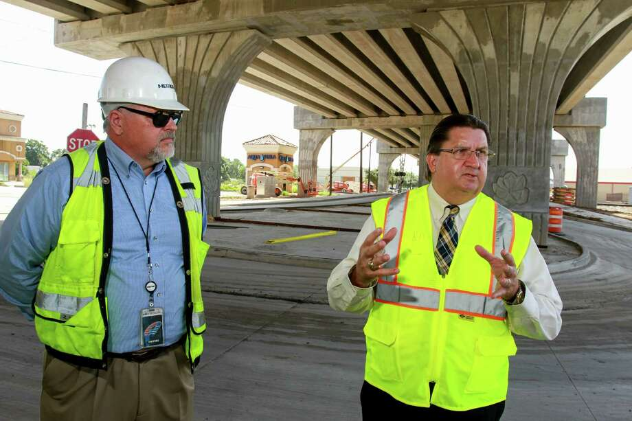 Bruce Krantz, left, and Tom Lambert, CEO of Metropolitan, talk about the Green Line rail project beneath the Harrisburg rail overpass in August 2016. Photo: Gary Fountain, For The Chronicle / Copyright 2016 Gary Fountain