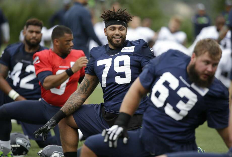 Third-year pro Garry Gilliam (center) will start at right tackle when the Seattle Seahawks kick off the 2016 season. Photo: Elaine Thompson/AP