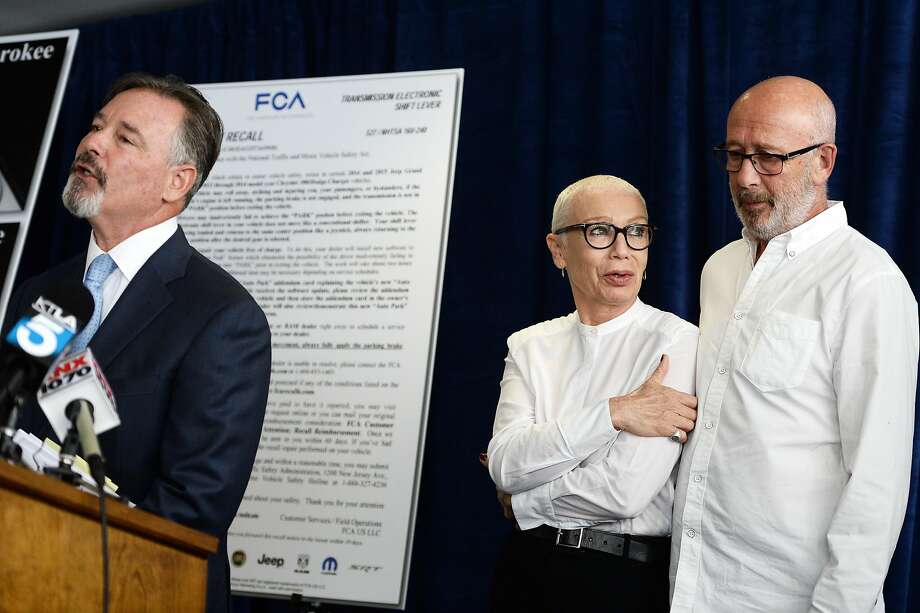 Attorney Gary Dordick and Anton Yelchin's parents, Irina and Victor Yelchin, outline the suit. Photo: Amanda Edwards, Getty Images