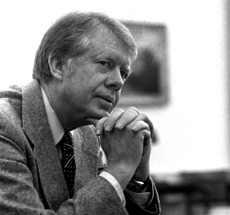 FILE - In this Jan. 24, 1977 file photo, President Jimmy Carter is interviewed in the Oval Office of the White House in Washington. Republican presidential candidate Donald Trump has alarmed U.S. allies in Asia and elsewhere by suggesting that American military support should depend on their willingness to pay. But he would not be the first U.S. president to consider shaking up time-honored military deployments. Four decades ago, then-President Carter tried to withdraw American troops in South Korea, and failed. He wanted to trim fat from the U.S. defense budget and put pressure on South Korea over human rights abuses, but hit a wall of opposition in his own administration and in Seoul. (AP Photo, File) ORG XMIT: WX303 / AP1977