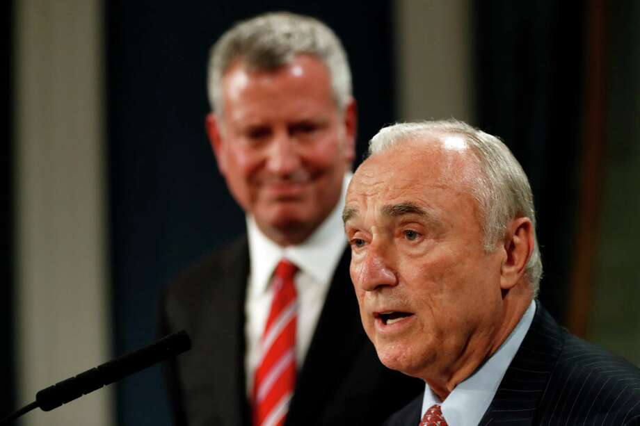 New York City Police Commissioner William Bratton is joined by Mayor Bill de Blasio during a news conference, Tuesday, Aug. 2, 2016, in New York's City Hall. Bratton is leaving the nation's largest police force, after a tenure in which he received credit for keeping crime down and navigated tension between police and minority communities. Mayor de Blasio announced Tuesday that Bratton will retire next month to enter the private sector, although he and Bratton wouldn't disclose details. James O'Neill, the department's top chief, will become commissioner. (AP Photo/Mary Altaffer) ORG XMIT: NYMA102 Photo: Mary Altaffer / Copyright 2016 The Associated Press. All rights reserved. This m