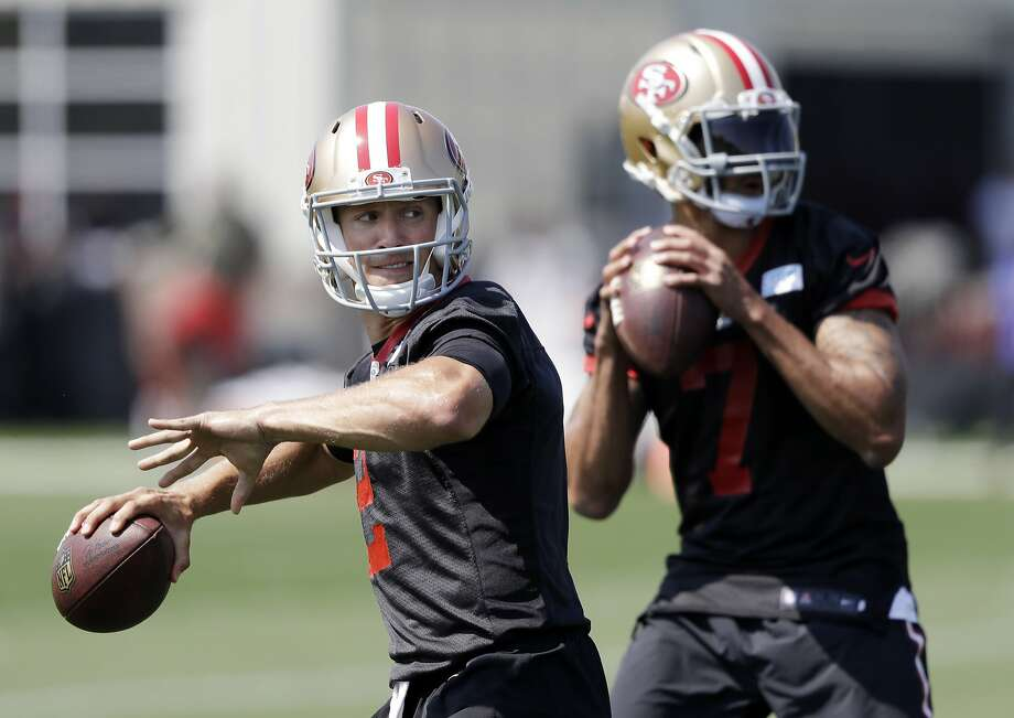 49ers quarterbacks Blaine Gabbert (left) and Colin Kaepernick split first-team snaps during practice as they compete to start. Photo: Marcio Jose Sanchez, Associated Press