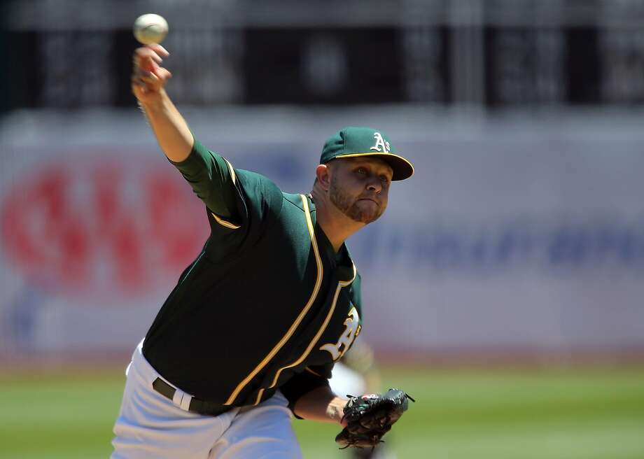 OAKLAND, CA - JULY 24: Jesse Hahn #32 of the Oakland Athletics pitches in the first inning against the Tampa Bay Rays at the Oakland-Alameda Coliseum on July 24, 2016 in Oakland, California.  (Photo by Don Feria/Getty Images) Photo: Don Feria, Getty Images