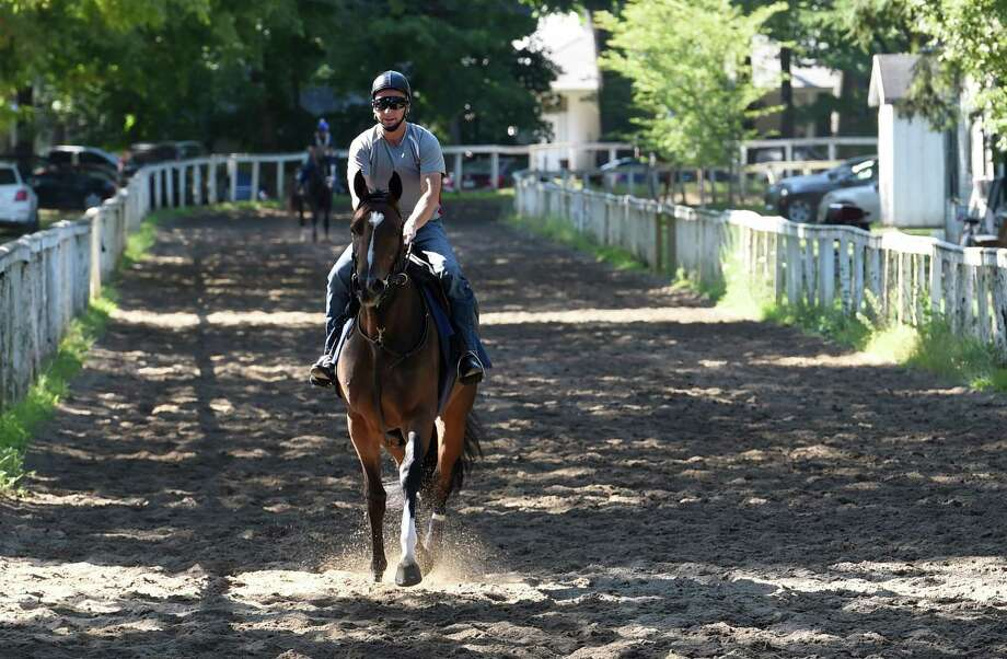 Carry Your Heels ridden by exercise rider Simon Harris goes out for a gallop Thursday July 28, 2016 on Clare Court track at the Saratoga Race Course in Saratoga Springs, N.Y.  Carry Your Heels was bred in New York by Dr. Michael Gallivan and is owned by Gatsas Staqbles and trained by John P. Terranova and is a two year old filly.  She was sired by Freud and her dam is Destiny Rose.   (Skip Dickstein/Times Union) Photo: SKIP DICKSTEIN