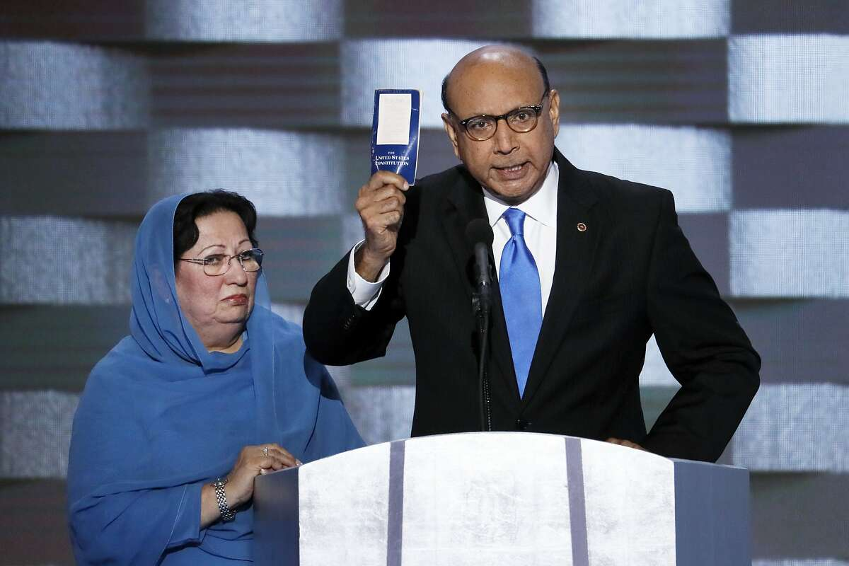 FILE - In this July 28, 2016 file photo, Khizr Khan, father of fallen US Army Capt. Humayun S. M. Khan holds up a copy of the Constitution of the United States as his wife listens during the final day of the Democratic National Convention in Philadelphia. Since Khan held up a copy of the U.S. Constitution at the convention, sales for the government�s founding document have soared. (AP Photo/J. Scott Applewhite, File)