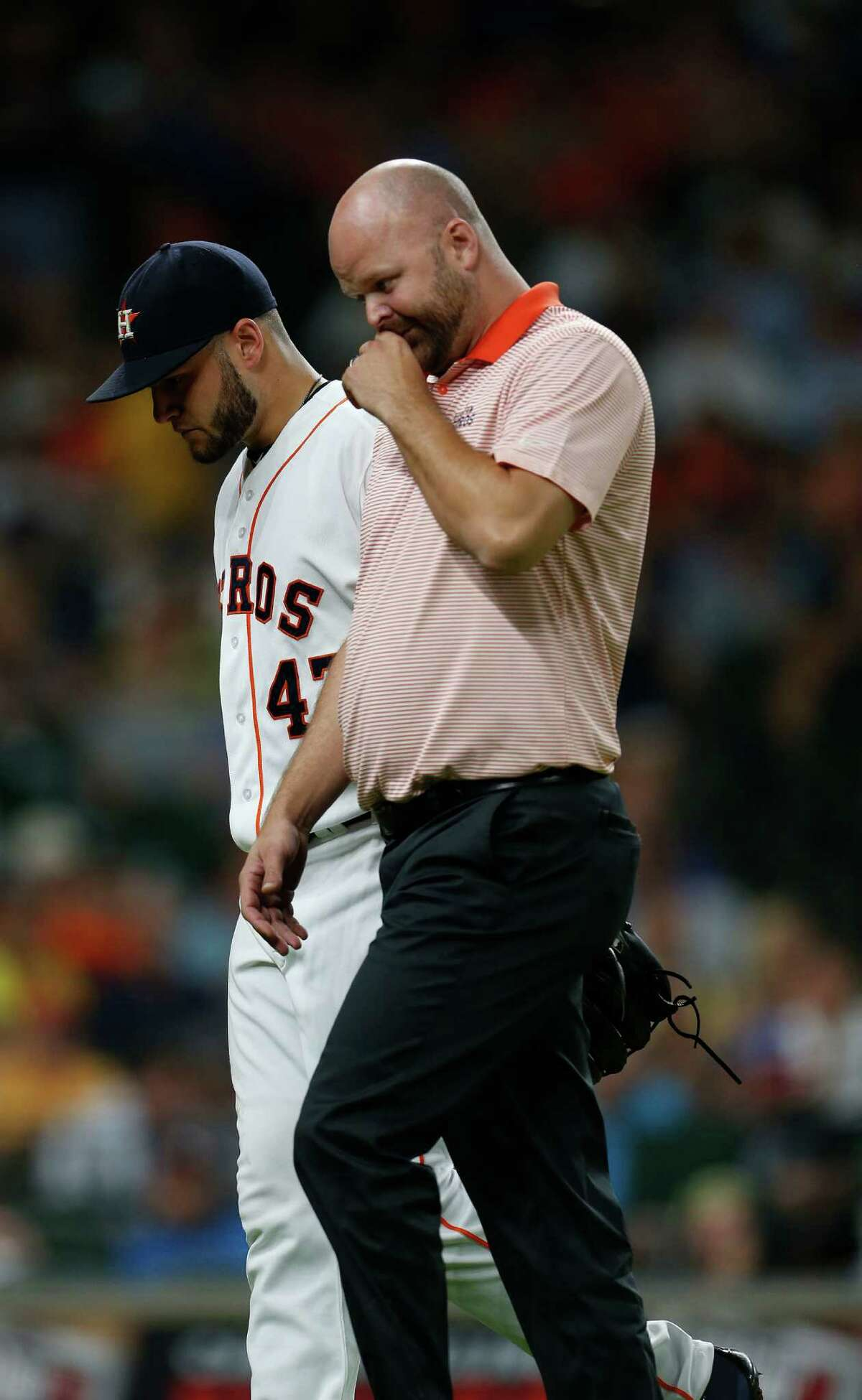 Houston Astros starting pitcher Lance McCullers (43) walks back to the dugout with trainer James Ready during the fifth inning of an MLB game at Minute Maid Park, Tuesday, Aug. 2, 2016, in Houston.