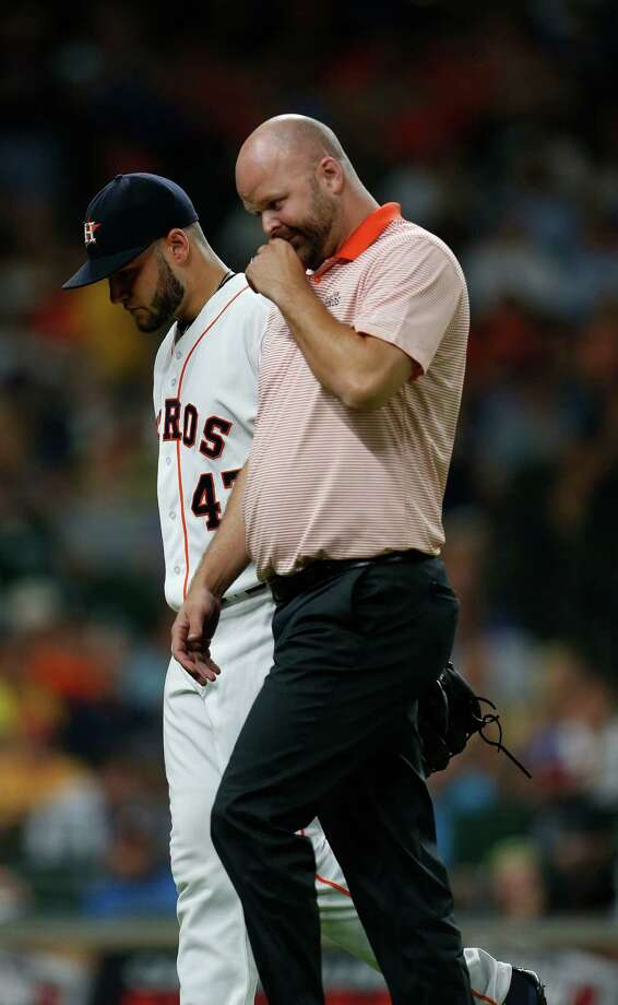 Houston Astros starting pitcher Lance McCullers (43) walks back to the dugout with trainer James Ready during the fifth inning of an MLB game at Minute Maid Park, Tuesday, Aug. 2, 2016, in Houston. Photo: Karen Warren, Houston Chronicle / © 2016 Houston Chronicle