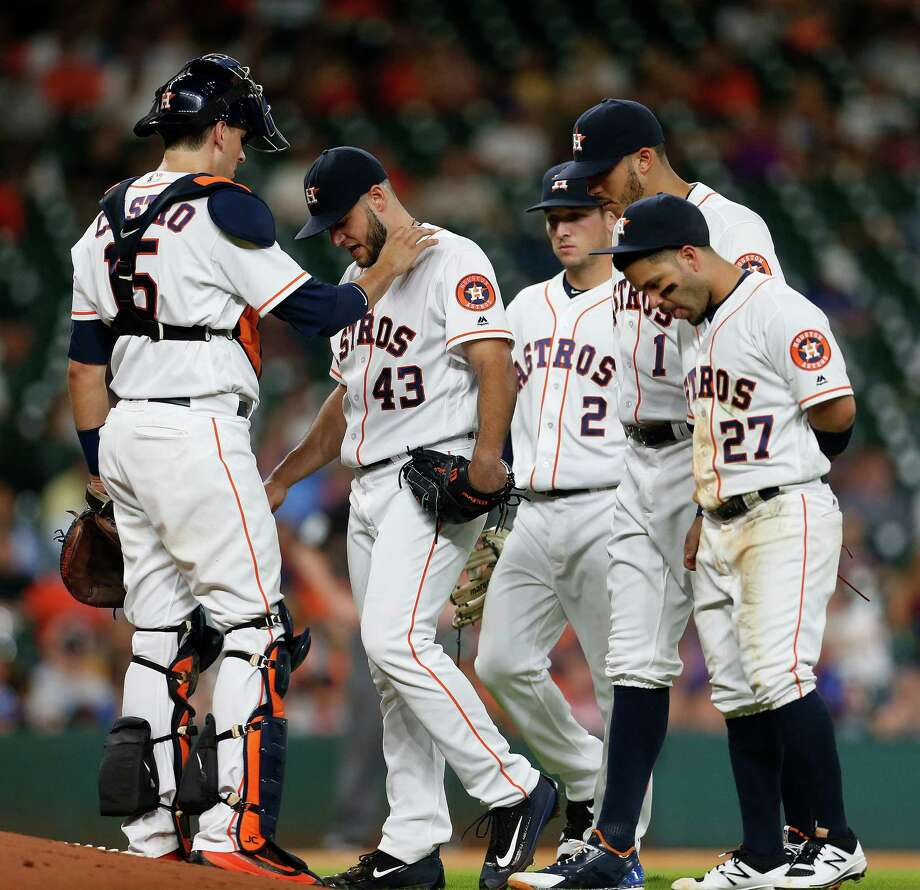 Houston Astros catcher Jason Castro (15) checks on starting pitcher Lance McCullers (43) as the rest of the infield came in during the fifth inning of an MLB game at Minute Maid Park, Tuesday, Aug. 2, 2016, in Houston. Photo: Karen Warren, Houston Chronicle / © 2016 Houston Chronicle