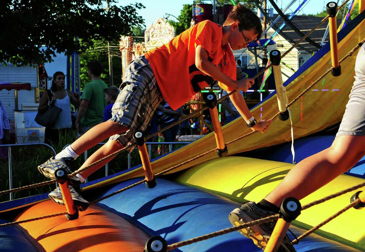 The Easton Volunteer Fire Department's 75th annual Fireman's Carnival at Sport Hill Road and Center Street in Easton, Conn., on Tuesday Aug. 2, 2016. The carnival, which runs through Saturday Aug. 6 from 6 p.m. to 11 p.m., features a range of amusement rides and games, bingo as well as foods like burgers and hot dogs and plenty of sweet treats.