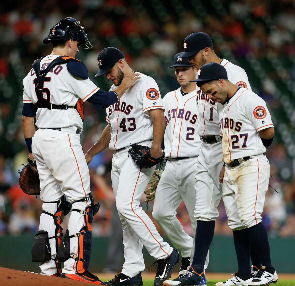 Catcher Jason Castro tries to console Lance McCullers after the starter left the game in the fifth with discomfort in his right elbow.