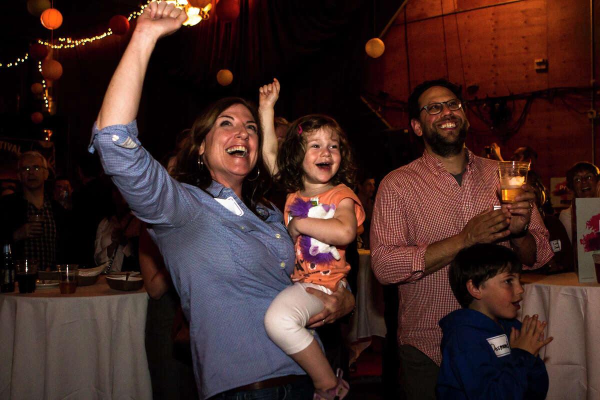 Pramila Jayapal supporters cheer as the results of for the 7th Congressional District candidate are revealed in her favor at Hale's Palladium on Tuesday, Aug. 2, 2016.