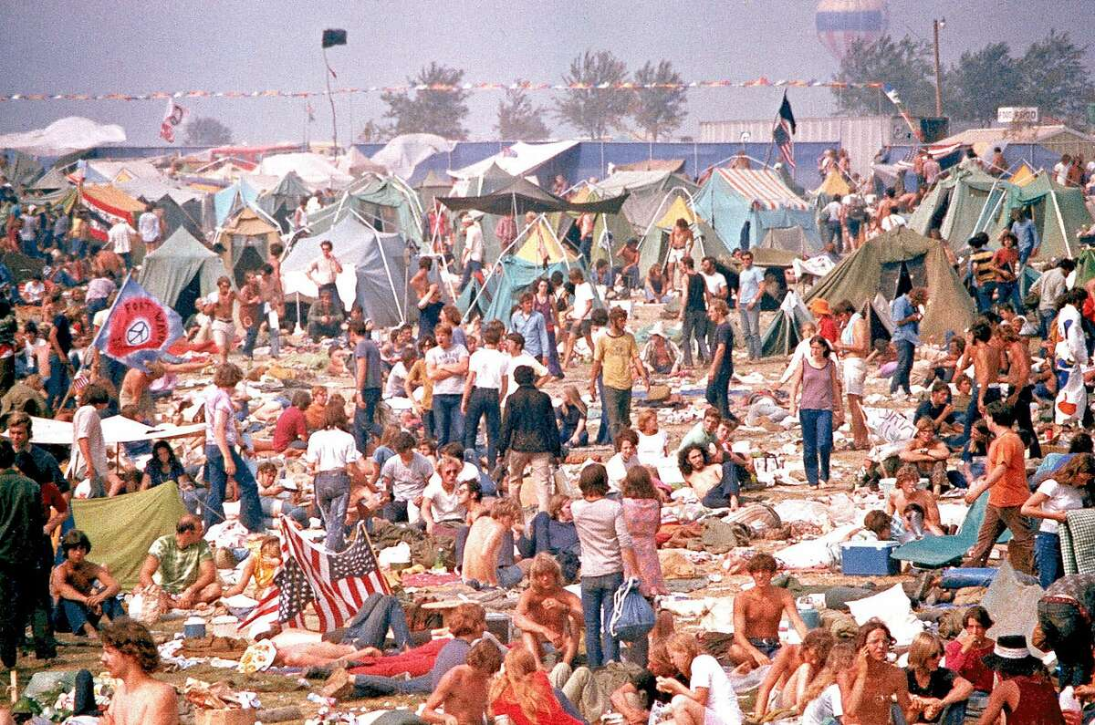 Music fans gather for the 'Gimme Shelter' rock concert at the Altamont Race Track in Altamont, Calif., on Dec. 6, 1969. The event was billed as a West Coast Woodstock, a huge free concert featuring Santana, the Grateful Dead, Crosby, Stills, Nash and Young and headlined by The Rolling Stones. Instead, that gathering 30 years ago turned into one of the most violent days in the history of rock 'n' roll, and signaled the end of the halcyon era of Flower Power. (AP Photo)