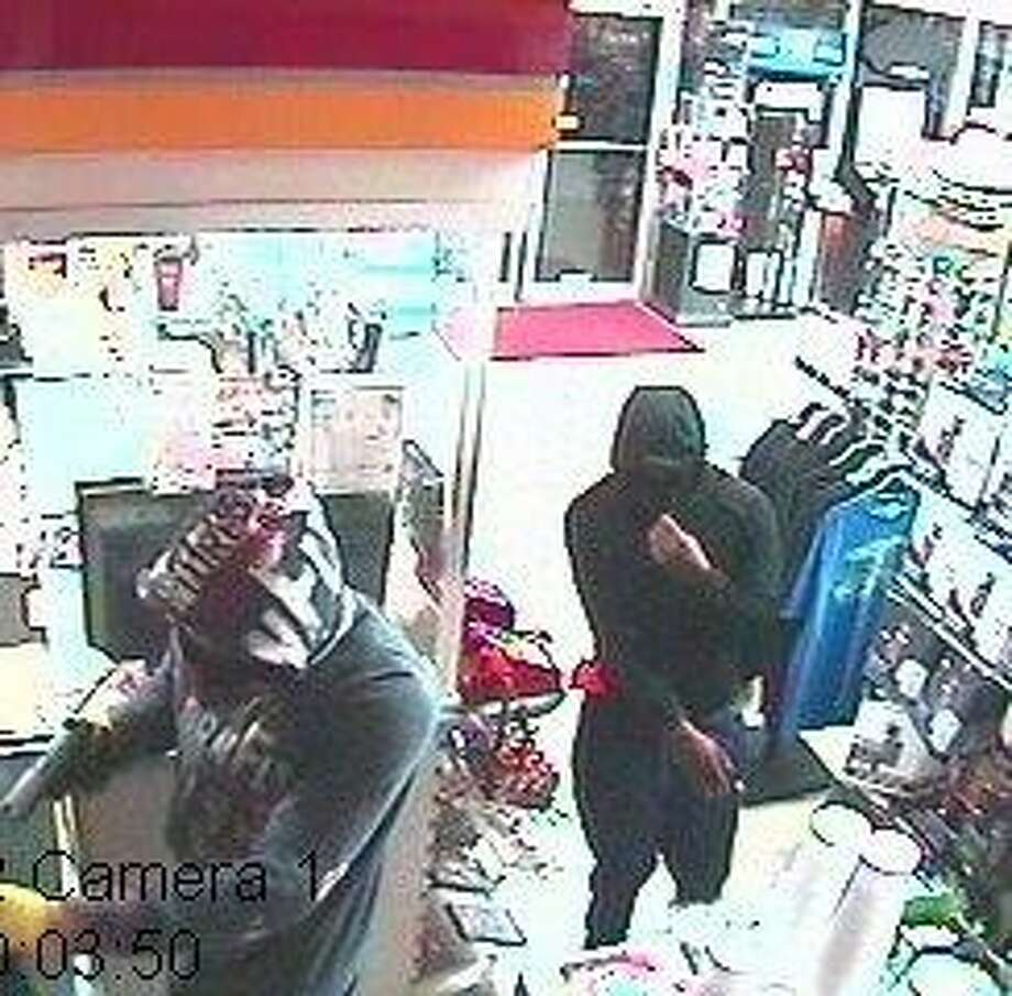 Police are searching for two men suspected in an armed robbery about 12:10 a.m. July 3, 2016, at a convenience store in the 1900 block of Clinton in Galena Park. (Crime Stoppers)