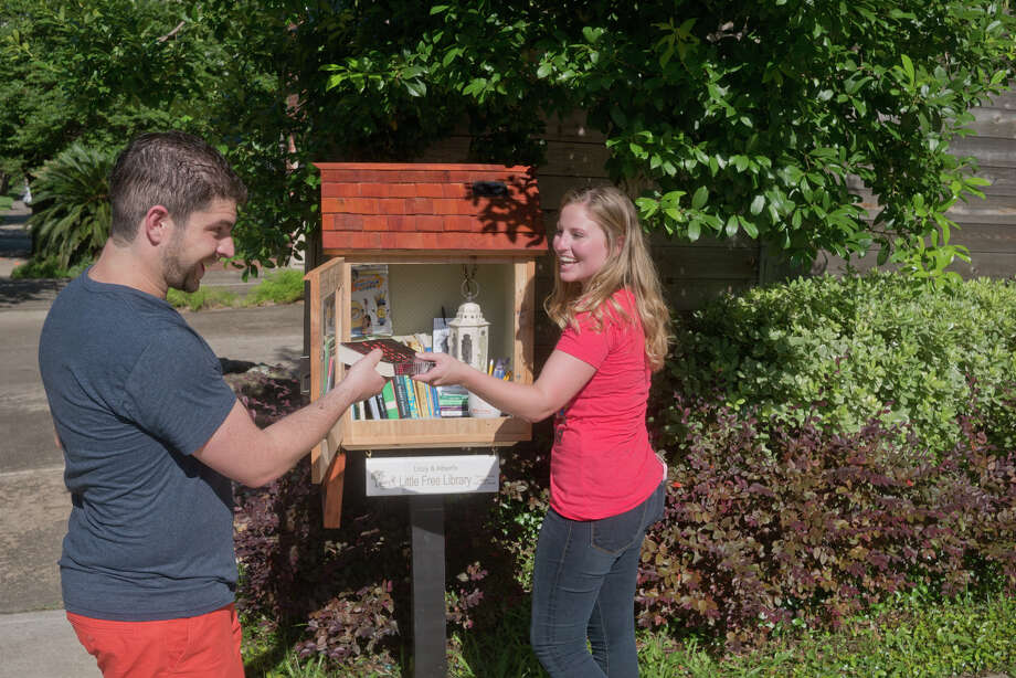 Albert Kamkhagi and Lizzy Wermuth at Lizzy & Albert's newly chartered Little Free Library at 1805 W. Main in Montrose. Photo: R. Clayton McKee, Freelance / © R. Clayton McKee