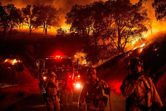 Firefighters set backfire while battling the Cold Fire near Winters, Calif., on Wednesday, Aug. 3, 2016.