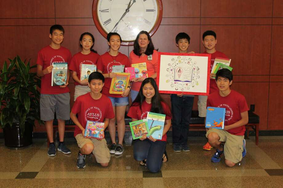 Members of the Alliance of Youth Leaders in the United States donate books to Memorial Hermann Southwest Hospital. Pictured in top row, from left, are Kevin Chen, Lauren Wang, Emily Wang, Beth Burris Bell, Eric Li, and Jonathan Liu. In the front row, from left, are Tony Liu, Clio Sun and Jason Jiang. Photo: Memorial Hermann Hospital System