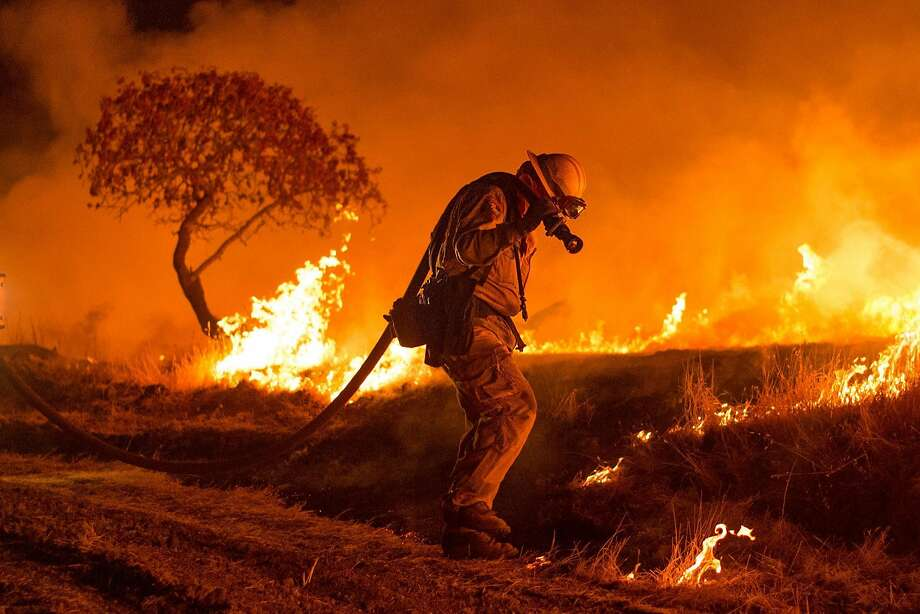 Firefighters set backfire while battling the Cold Fire near Winters, Calif., on Wednesday, Aug. 3, 2016. Photo: Noah Berger, Special To The Chronicle
