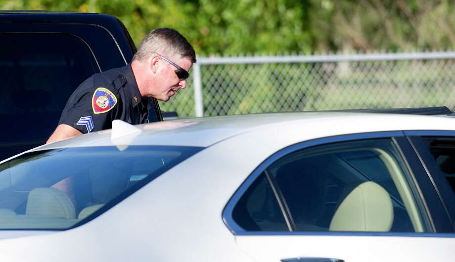 Police Sgt. Andrew Gallagher pulls over vehicles during a traffic stop to ticket drivers for all violations, including blocking the box, at the intersection of Palmer Hill Road and Westover Road in Stamford, Conn., on October 3, 2014. Photo: Lindsay Perry / Lindsay Perry / Stamford Advocate