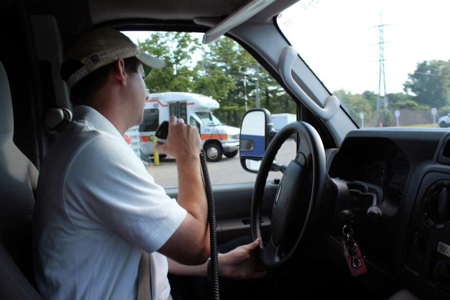 Nick Cohen at the wheel on his way to a call in Darien, Conn. on July 27, 2016. Photo: Justin Papp / Hearst Connecticut Media / Darien News