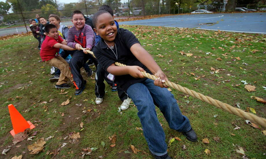 FILE PHOTO: Amir Micntosh, 9, plays tug-of-war during a Fall Festival Celebration at the Boys and Girls Club in Stamford, Conn., on Friday, October 24, 2014. Photo: Lindsay Perry / File Photo / Stamford Advocate