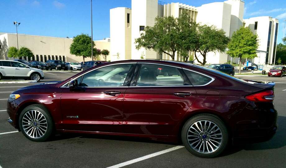 The 2017 Ford Fusion Hybrid Titanium parked in front the Houston Chronicle building. Photo & Review: 2017 Ford Fusion Hybrid Titanium - Houston Chronicle markmcfarlin.com