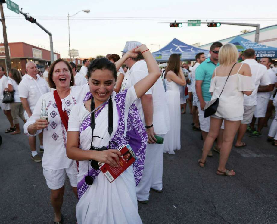 Suzie Haines dances with Govardhanesvari Devi Dasi at White Linen Night in the Heights. Photo: Jon Shapley, Staff / © 2015 Houston Chronicle
