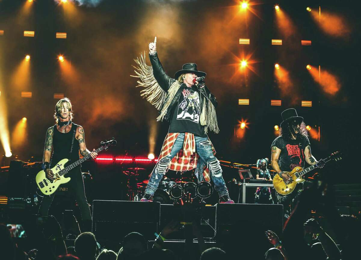 Guns N' Roses - featuring Duff McKagan, from left, Axl Rose and Slash - brings its revamped rock 'n' roll show to Houston on Friday.